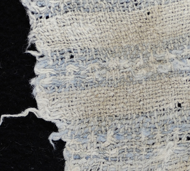 zoom-cotton-plain-weave-with-indigo-blue-yarns-forming-a-warp-stripe-on-one-edge-and-weft-bands-with-a-float-patterning-for-a-6000-year-old-artifact-photo-by-lauren-urana